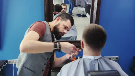 Barber-Trimming-Beard-For-Client-Using-Scissors