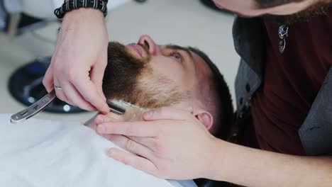 Barber-Using-Razor-Blade-To-Shave-Client-s-Neck