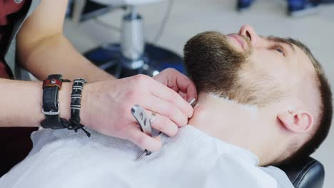 Barber-Puts-Finishing-Touches-On-Beard-Using-Razor