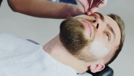 Barber-Shaving-Client-s-Beard-With-Razor-Blade