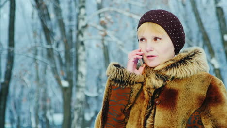 Woman-Uses-Smartphone-In-Winter-Scene-04