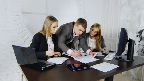 Young-professionals-analysing-business-documents-03-