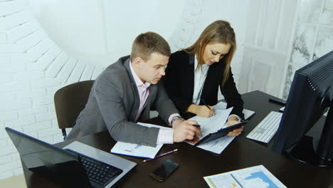 Young-Businesswoman-Working-With-Her-Assistant