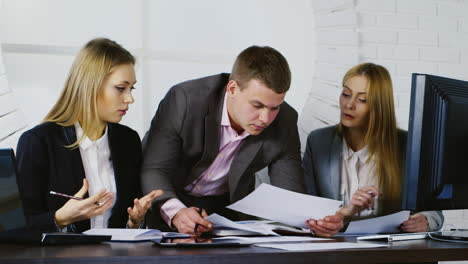 young-Business-professionals-discussing-documents