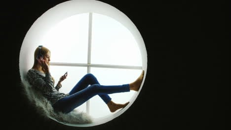Woman-Listening-to-Music-in-Round-Window
