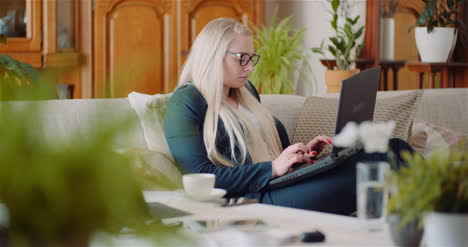 Businesswoman-Doing-Home-Office-Work-On-Laptop-Computer-Woman-Writing-Email-On-Laptop-2