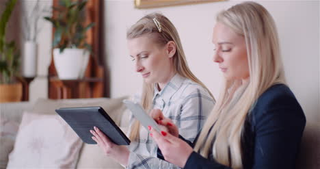 Businesswomen-Discussing-Over-Technologies-In-Office-Businesswomen-Working-On-Digital-Tablet-1