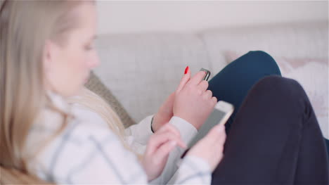 Two-Young-Women-Doing-Online-Shopping-On-Smartphone-Browsing-Internet-Social-Media