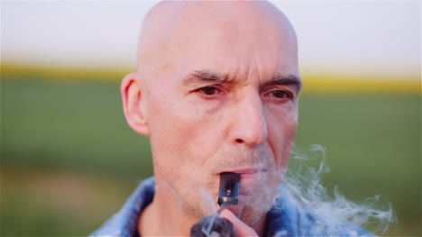Contented-Bald-Farmer-Smoking-His-Pipe-On-Field-4