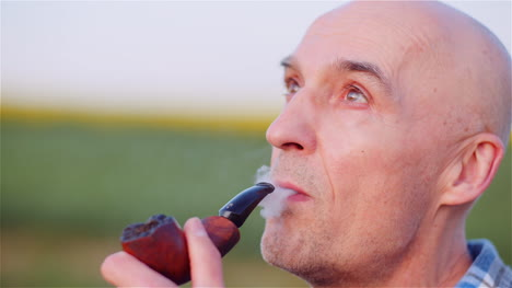 Contented-Bald-Farmer-Smoking-His-Pipe-On-Field-6