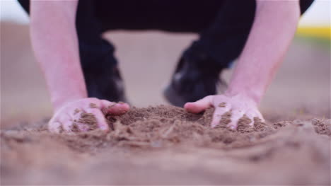 Farmer-Examining-Organic-Soil-In-Hands-Farmer-Touching-Dirt-In-Agriculture-Field-2