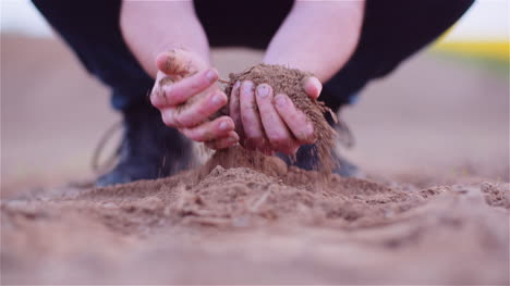 Farmer-Examining-Organic-Soil-In-Hands-Farmer-Touching-Dirt-In-Agriculture-Field-3