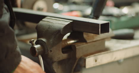Man-Working-At-Metal-Industry-Cutting-And-Measuring-Metal-Parts-At-Workshop-5