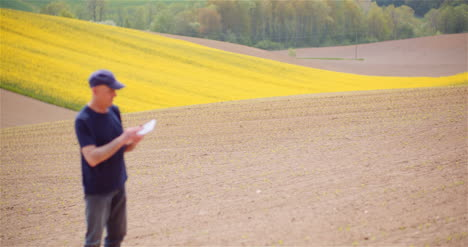 Agriculture-Technology-Concept-Farmer-Examining-Agriculture-Field-Working-On-Digital-Tablet-5