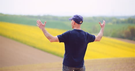 Successful-Male-Agronomist-Gesturing-On-Field-1