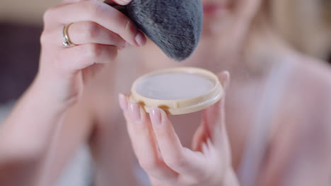 Attractive-Female-Doing-Makeup-Applaying-Powder