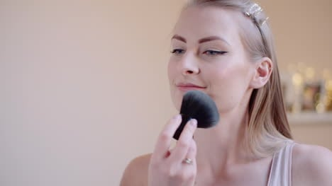 Attractive-Female-Doing-Makeup-Applaying-Powder-1