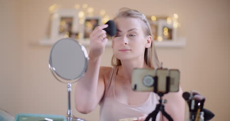 Young-Woman-Doing-Makeup-In-Front-Of-Mirror-At-Home-2