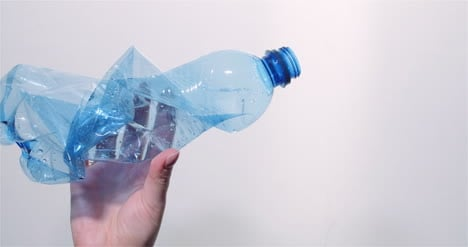 Plastic-Recycling-Woman-Holding-Plastic-Bottle-Waste-In-Hand