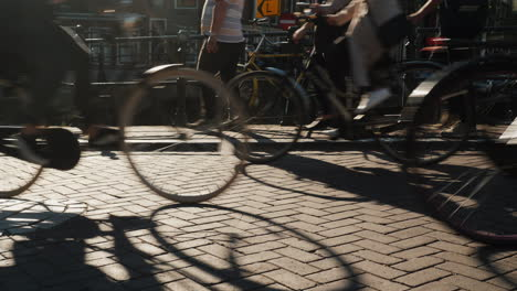 Bicycles-And-Pedestrians-On-Narrow-Bridge-In-Amsterdam