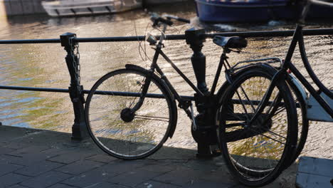 Bicycles-by-Canal-in-Amsterdam
