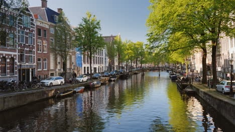 Scenic-Canal-in-Amsterdam-with-Boats
