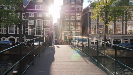 Tourists-On-A-Picturesque-Bridge-in-Amsterdam