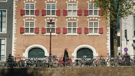Amsterdam-Bicycles-Against-Typical-Brick-Houses