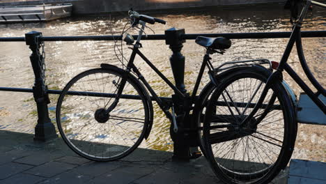 Bicycle-by-Canal-Railings-In-Amsterdam