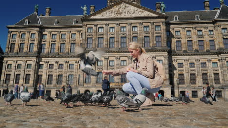 Woman-Is-Feeding-Pigeons-In-Dam-Square