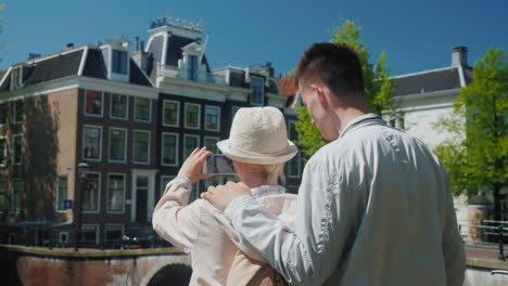 Mom-and-Son-Take-Photo-of-Amsterdam