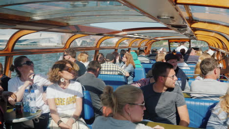 Passengers-on-Amsterdam-Canal-Cruise