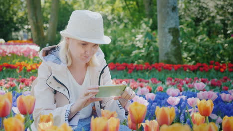 Woman-on-her-Phone-Surrounded-by-Tulips