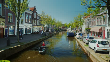 Rowboat-on-Canal-in-Delft-in-The-Netherlands