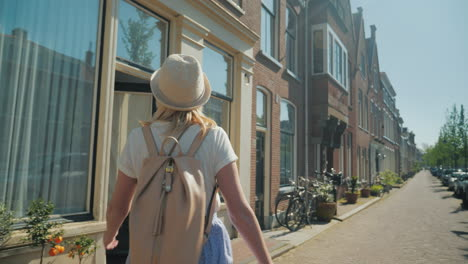 Woman-In-A-Hat-Walking-Through-Delft