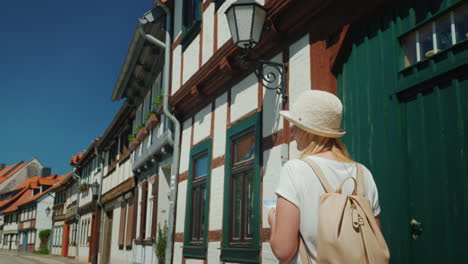 Tourist-With-Map-in-Old-German-Street