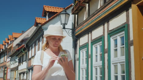 Woman-With-Smartphone-in-Old-German-Street