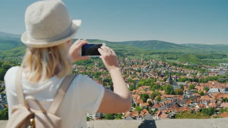 Woman-Takes-A-Picture-of-Old-German-Town
