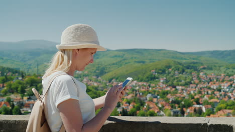 Tourist-With-A-Smartphone-in-German-Countryside