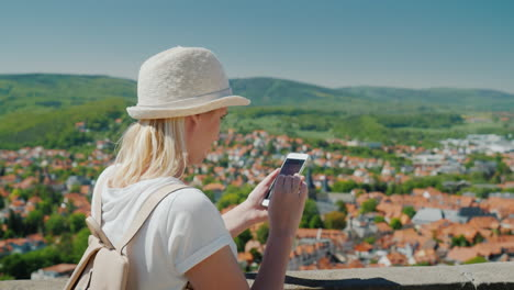 Tourist-With-Smartphone-Above-German-Rooftops