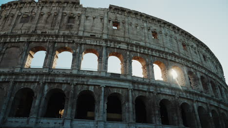 Sunrise-Through-Arches-of-the-Colosseum-Rome