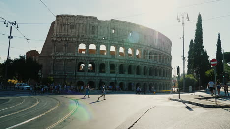 Cars-And-Pedestrians-by-the-Colosseum-Rome