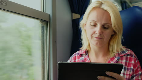 Woman-Uses-Tablet-on-a-Train