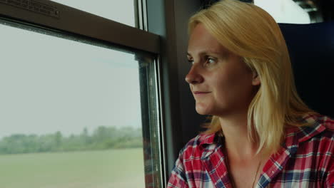 Woman-Looks-out-of-Train-Window
