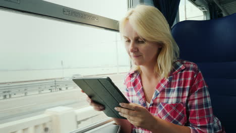 Woman-On-A-Train-Using-a-Tablet