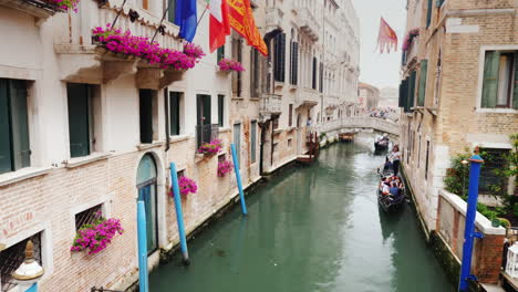 Gondolas-on-Narrow-Canal-In-Venice