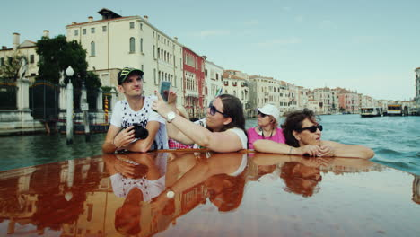 Tourists-Sail-Down-The-Grand-Canal-In-Venice