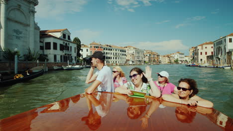 Tourists-Photograph-Venice-From-Boat