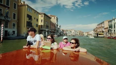 Tourists-Viewing-Venice-from-Boat