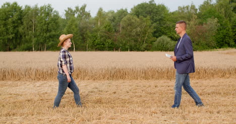 Agriculture-Farmer-Talking-With-Businessman-At-Harvesting